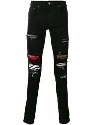 QUẦN AMIRI BLACK DESTROYED JEANS