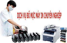 Đổ mực máy in.