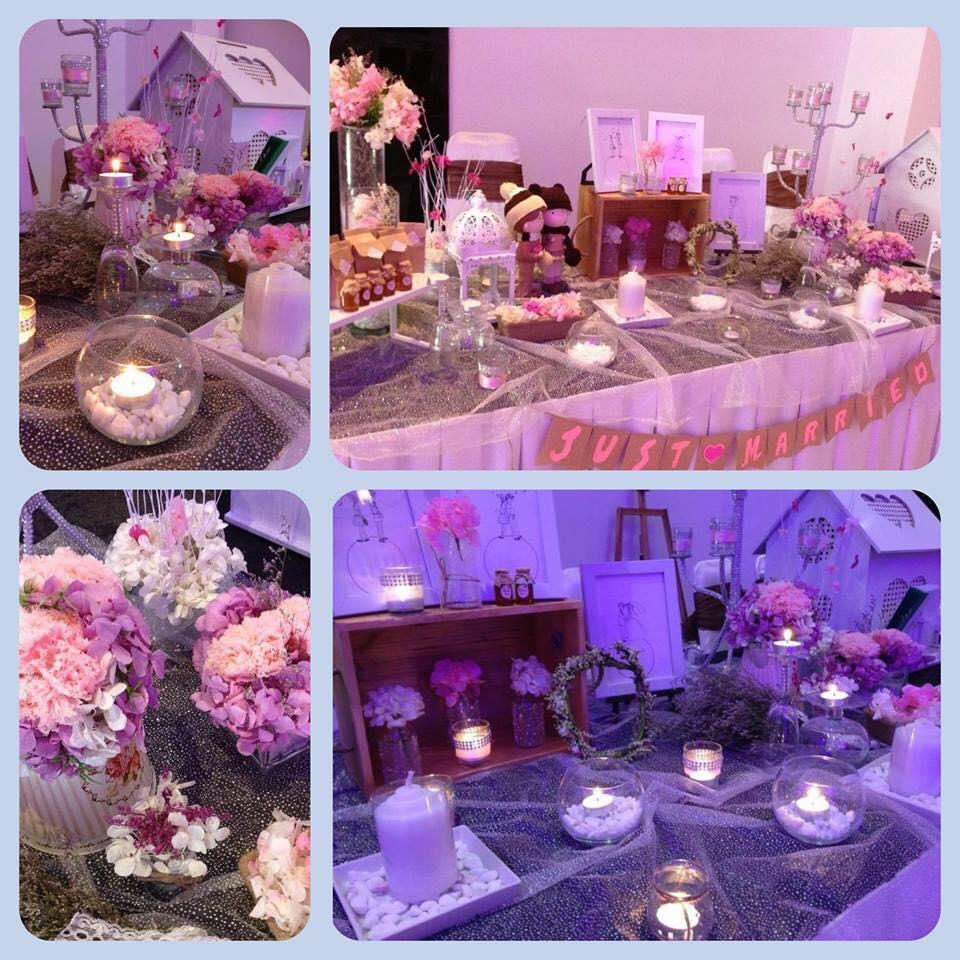 trang trí bàn đón khách tiệc cưới màu hồng tím