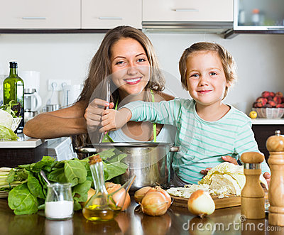 couple-cooking-kitchen-dinner-34070377.jpg